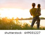 mom and daughter on the river... | Shutterstock . vector #649031227