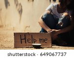 Small photo of Poor woman begging for help on the street