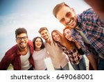 group of young people standing... | Shutterstock . vector #649068001