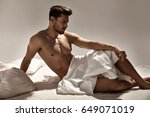 handsome  muscular guy posing... | Shutterstock . vector #649071019