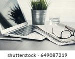 newspaper with computer on table | Shutterstock . vector #649087219