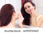young woman removing makeup in... | Shutterstock . vector #649093465