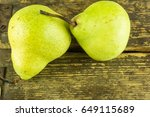 Green Pears On A Rustic Wooden...