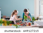a young mother and her little... | Shutterstock . vector #649127215