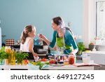 a young mother and her little... | Shutterstock . vector #649127245