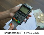 pos terminal with card in hand | Shutterstock . vector #649132231