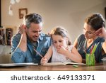 mom and dad help their little... | Shutterstock . vector #649133371