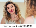 beautiful woman paints lips... | Shutterstock . vector #649134751