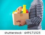 male volunteer holding donation ... | Shutterstock . vector #649171525