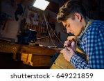 master artisan luthier working...   Shutterstock . vector #649221859