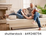 happy mature couple using... | Shutterstock . vector #649248754