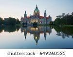 Stock photo the city hall rathaus of hannover reflected in pool day at twilight 649260535