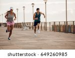 two young people sprinting... | Shutterstock . vector #649260985