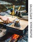 man is cooking turkish coffee... | Shutterstock . vector #649275745