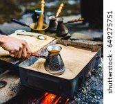 man is cooking turkish coffee... | Shutterstock . vector #649275751