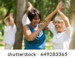 happy senior woman working out... | Shutterstock . vector #649283365