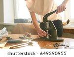 female artisan using manual... | Shutterstock . vector #649290955