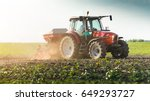 farmer with tractor seeding  ... | Shutterstock . vector #649293727