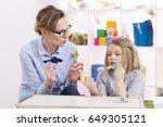 female teacher using colorful...   Shutterstock . vector #649305121