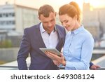 business couple looking at...   Shutterstock . vector #649308124