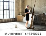 woman painter holding a brush... | Shutterstock . vector #649340311