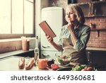 beautiful mature woman in apron ... | Shutterstock . vector #649360681