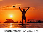 paddle boarder. black sunset... | Shutterstock . vector #649363771