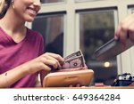 woman paying cash for bill... | Shutterstock . vector #649364284