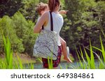 woman with toddler wears... | Shutterstock . vector #649384861