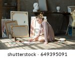woman painter sitting on the... | Shutterstock . vector #649395091