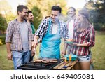 happy friends enjoying barbecue ... | Shutterstock . vector #649405081