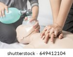 CPR training medical procedure,Demonstrating chest compressions on CPR doll in the class