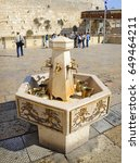 Small photo of Yerushalayim, Middle East, May 2016. Famous antique holyland sacred relic place of judaic capital. Past israelite divine belief pilgrims crying. Old golden crane and mug on chain. Scenic town view