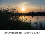 Lake On A Sunset Background