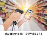 supermarket female cashier use...   Shutterstock . vector #649488175