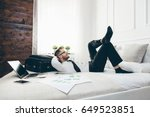 young businessman on bed... | Shutterstock . vector #649523851
