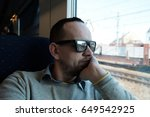 man sitting in train and... | Shutterstock . vector #649542925