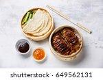 peking duck in bamboo steamer... | Shutterstock . vector #649562131