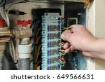 electrician's hands are... | Shutterstock . vector #649566631