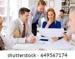 coworkers working on project... | Shutterstock . vector #649567174