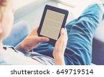 Man reading an e book on...