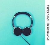 pair of black headphones on a...   Shutterstock . vector #649752361