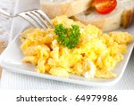 fresh scrambled eggs with parsley and bread - stock photo