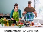 a cheerful couple cooking... | Shutterstock . vector #649841755