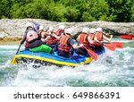 rafting group at a river in austria - stock photo