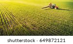 tractor spraying pesticides on... | Shutterstock . vector #649872121