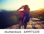 successful woman hiker shouting ... | Shutterstock . vector #649971235