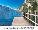 wooden wharf on  lake garda in... | Shutterstock . vector #649983031