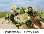 Hands Making Flower Chain Of...