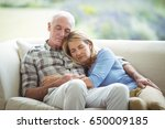 senior couple relaxing on sofa... | Shutterstock . vector #650009185